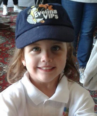 Riley in her VIPs hat