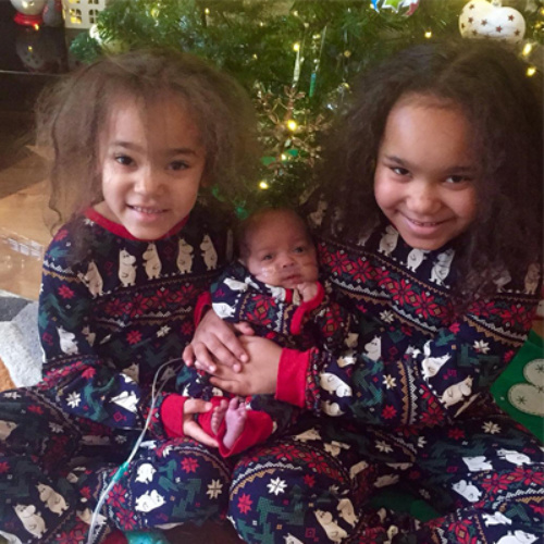Sayanna, with her sisters, Lola and Lily.