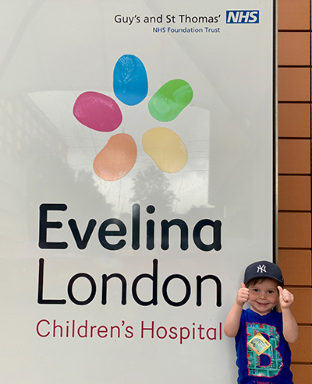 George McCann, by the Evelina London sign, at the entrance of the hospital