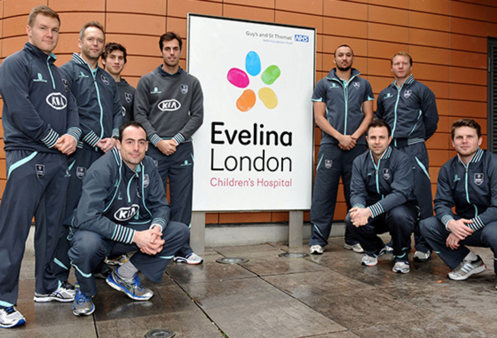 surrey county cricket club team photo with evelina logo in the middle