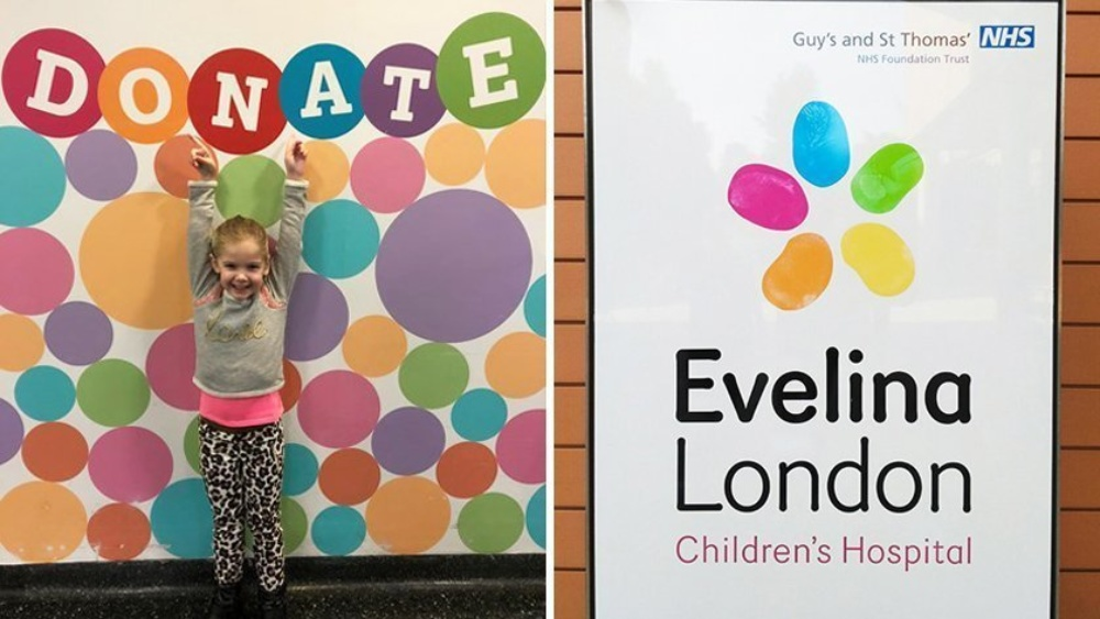 happy girl on the colourful donate wall behind her stretching up the arms high, up to the left and evelina london childrens charity logo to the right