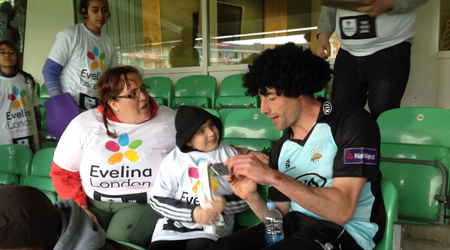 Boy with his mum, chatting to cricketer