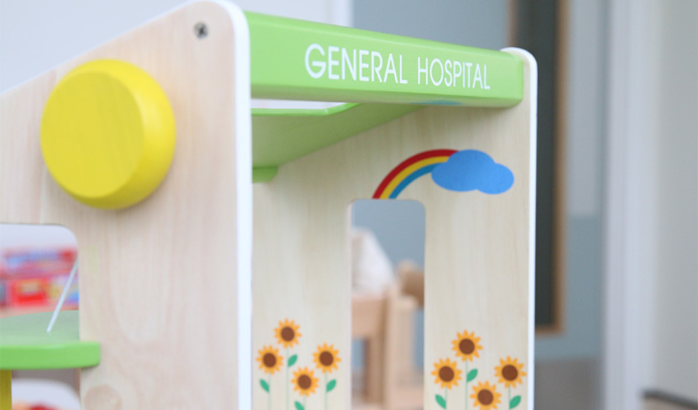 A hospital building toy, in a children's hospital ward